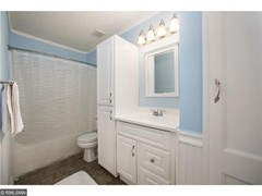 Upper level full bath with walk thru to the master bedroom w/ brand new vinyl flooring.
