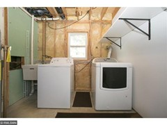 Laundry/Mechanical Room w/ water softener. Both dryer and water heater are gas.